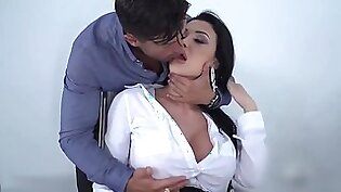 Busty office lady is using her sensual lips to satisfy guys, before getting fucked hard