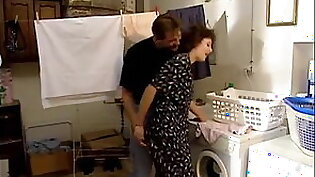 Mom and son in laundry room