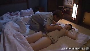 A guy wakes his sleeping Japanese wife by sucking her nipples